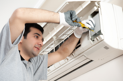 Electrician working on AC
